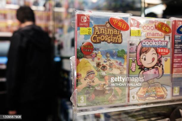 Copy of Nintendo computer game Animal Crossing: New Horizons is displayed in a shopping mall as a customer browses other games in Hong Kong on April...