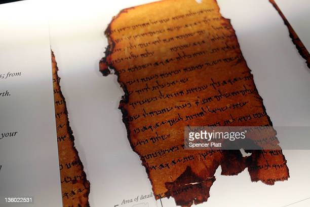 A copy of part of the Dead Sea Scrolls is displayed at the Dead Sea Scrolls Life and Faith in Biblical Times exhibition at Discovery Times Square on...