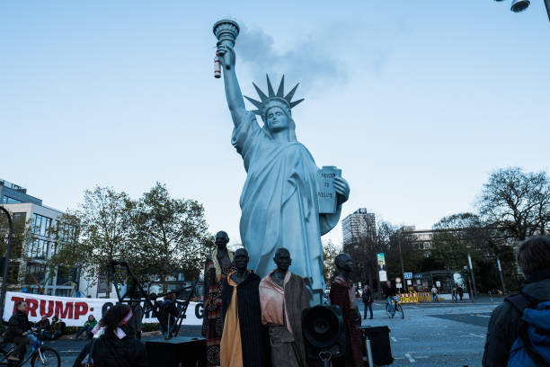a copy of statue of liberty seen during the protest as cop