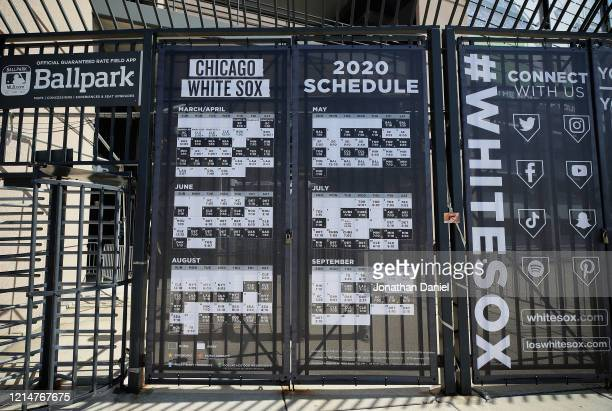 A copy of the 2020 season schedule for the Chicago White Sox is seen posted at a gate at Guaranteed Rate Field where the White Sox were scheduled to...