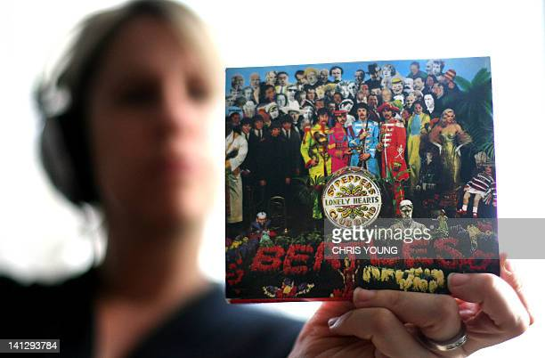 A copy of The Beatles 'Sgt Peppers Lonely Hearts Club Band' album is held by a listener in London 01 June 2007 Today marks to 40th anniversary of the...