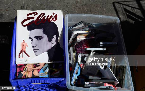 A copy of the book 'Elvis' by William Allen is among the items for sale at a flea market in the Chelsea district of New York City
