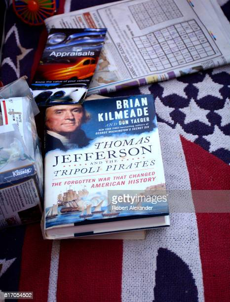 A copy of the book 'Thomas Jefferson and the Tripoli Pirates' by Brian Kilmeade sits on the seat of a classic car at a Fourth of July celebration in...