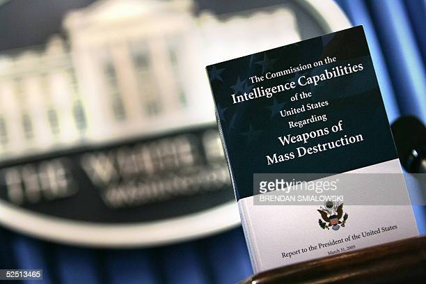 A copy of the Commission on the Intelligence Capabilities of the United States Regarding Weapons of Mass Destruction is pictured at White House 31...