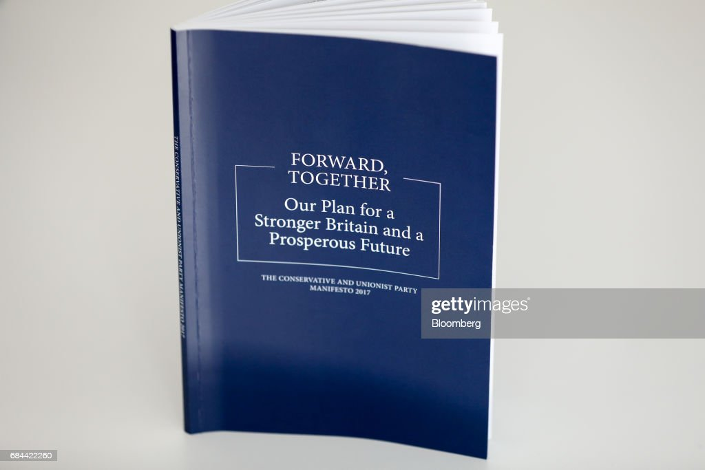 A copy of the Conservative Party manifesto stands on display during its launch at Dean Clough Mills in Halifax, U.K., on Thursday, May 18, 2017. Maypositioned herself as the champion of 'ordinary, working people' against 'elites' as she set out an election platform that represents a clean break with the way Britain has been governed for at least 30 years. Photographer: Chris Ratcliffe/Bloomberg via Getty Images