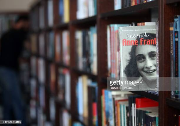 A copy of 'The Diary of Anne Frank' is seen on a bookshelf in a public library in Zagreb on February 14 2019 A decision to drop Jewish Anne Frank's...