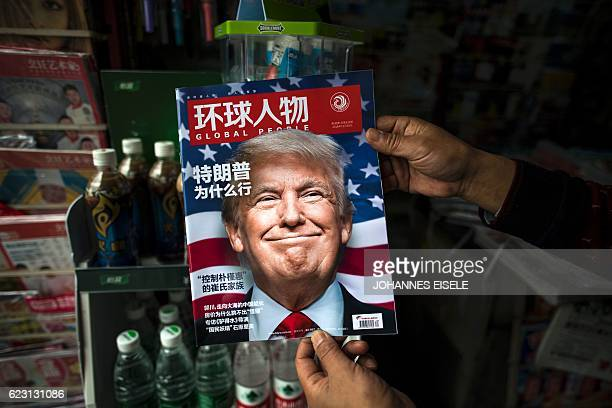 TOPSHOT A copy of the local Chinese magazine Global People with a cover story that translates to 'Why did Trump win' is seen with a front cover...