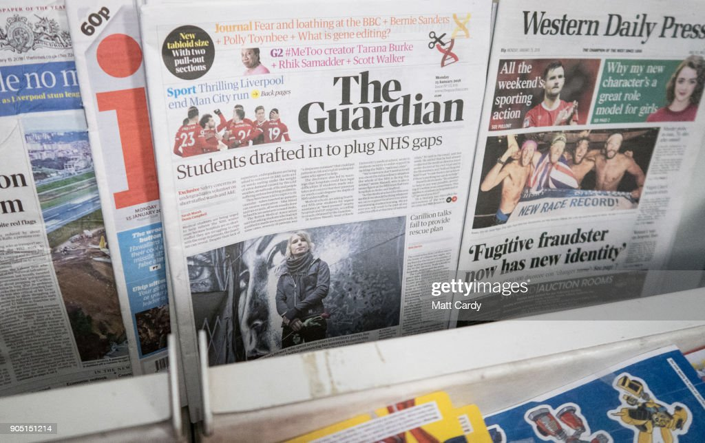A Copy Of The New Tabloid Sized The Guardian Newspaper With Its New  Masthead Is Pictured