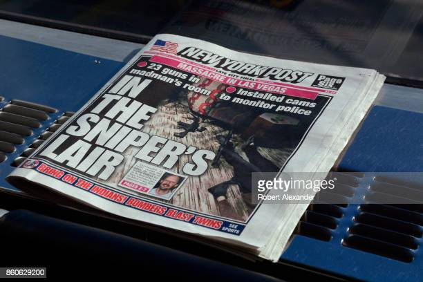 A copy of the New York Post discarded in the terminal at LaGuardia Airport in New York New York The headline refers to a mass murder in Las Vegas...