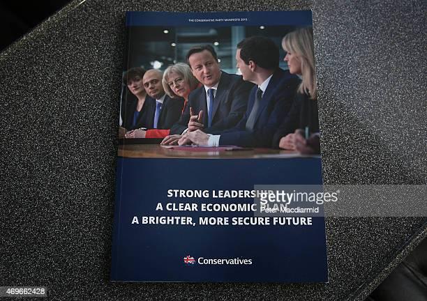 A copy of the newly released Conservative party election manifesto is shown to reporters on April 14 2015 in London England As the general election...