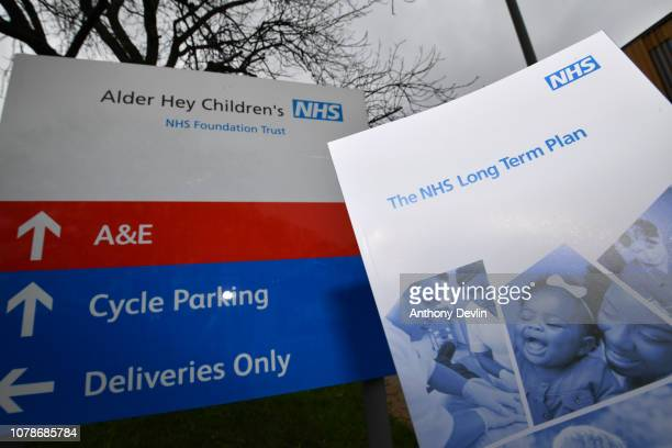 Copy of 'The NHS Long Term Plan' booklet is seen next to a sign for Alder Hey Children's Hospital on January 7, 2019 in Liverpool, England. The Prime...