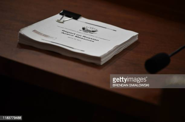 """Copy of the """"Report on the Russian Active Measures"""" is viewed during the testimony of Fiona Hill, the former top Russia expert on the National..."""