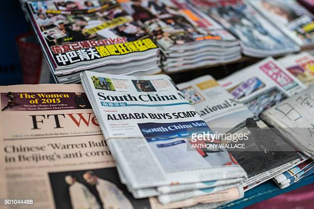 A copy of the South China Morning Post is displayed at a newsstand in Hong Kong on December 12 following its acquisition by Chinese internet giant...