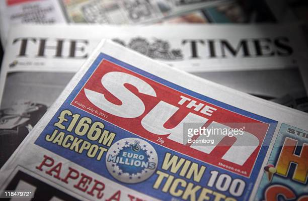 Copy of The Sun and The Times newspapers, published by News International Newspapers Ltd, are seen on display at a newsagents in London, U.K., on...