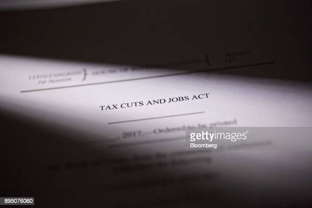A copy of the 'Tax Cuts and Jobs Act' a 1097page Republican tax bill including 503 pages of legislative text is arranged for a photograph in Tiskilwa...
