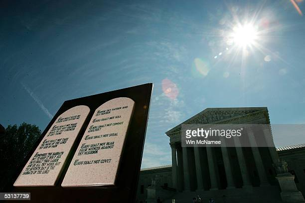 A copy of the Ten Commandments is displayed outside the US Supreme Court June 23 2005 in Washington DC Opponents and proponents of the church and...