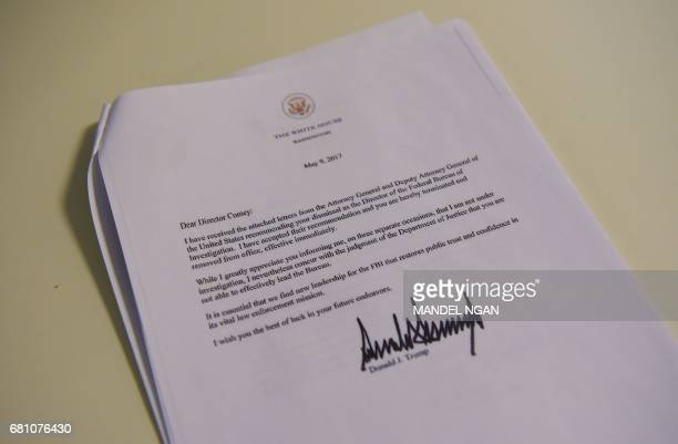 A copy of the termination letter to FBI Director James Comey from US President Donald Trump is seen at the White House on May 9 2017 in Washington DC...