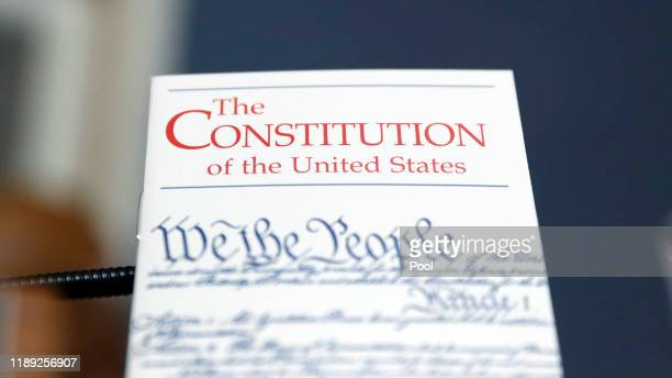Copy of the U.S. Constitution is propped up in front of the desk of Rep. Alcee Hastings during a House Rules Committee hearing on the impeachment...