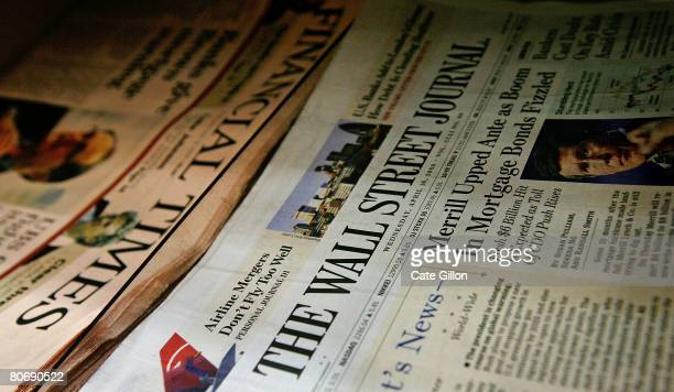 A copy of the US Edition of The Wall Street Journal lies next to a copy of The Financial Times newspaper on a news stand on April 16 2008 in London...