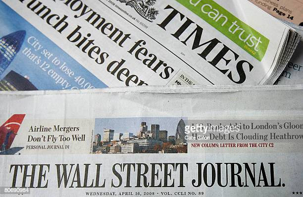 Copy of the U.S. Edition of The Wall Street Journal lies on a copy of The Times, both of which have been purchased at the same London newsagent on...