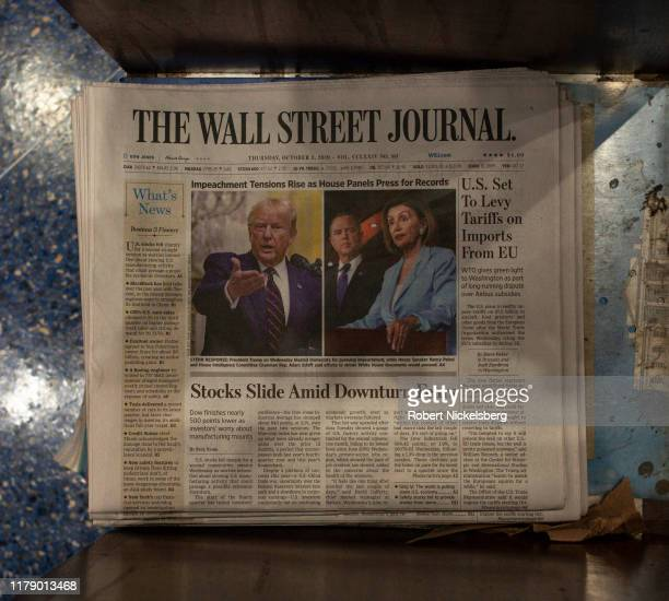 Copy of the Wall Street Journal sits on a rack at a newsstand in Grand Central Station in New York City on October 3, 2019. The Wall Street Journal...