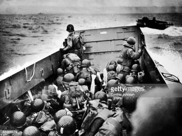 Copy print of American soldiers aboard an LCI landing craft on its way across the English Channel towards the beaches of Normandy for Operation...