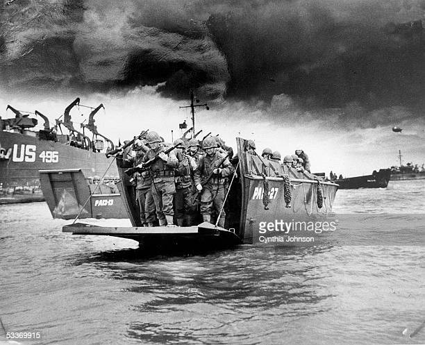 Copy print of American soldiers disembarking from an LCI landing craft upon its arrival on the beaches of Normandy for Operation Overlord aka the...