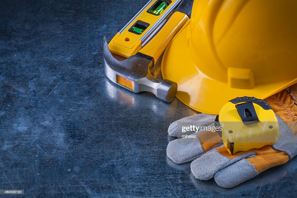 Copy space image of safety gloves hard hat construction level : Stockfoto