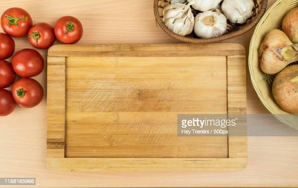 copy space image of wood board surrounding by fresh products - cooking utensil stock pictures, royalty-free photos & images