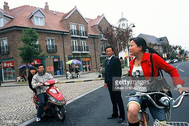 Copy Towns in China on January 02, 2008-Chinese residents stroll around the streets of Thames town,a british themed town near Shanghai. As China's...