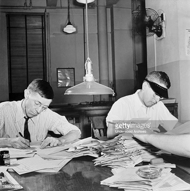 Copyreaders at the foreign desk in the newsroom of the New York Times newspaper New York New York September 1942