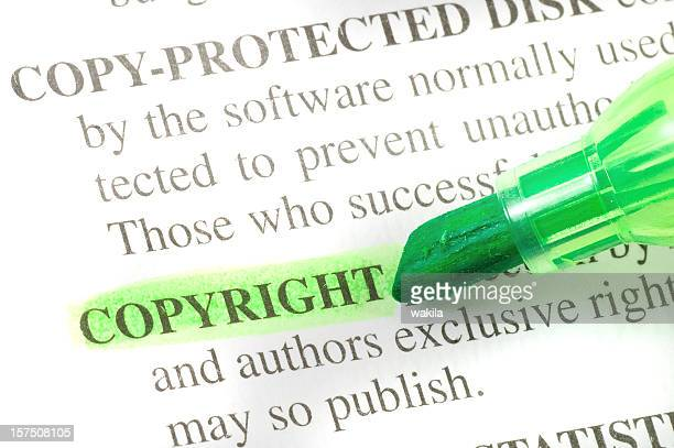 copyright defintion highligted in dictionary - denotation - intellectual property stock pictures, royalty-free photos & images