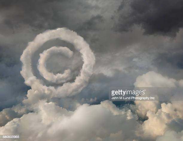 copyright symbol in cloudy sky - intellectual property stock pictures, royalty-free photos & images