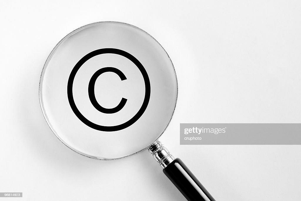 Copyright symbol in the microscope : Stock Photo