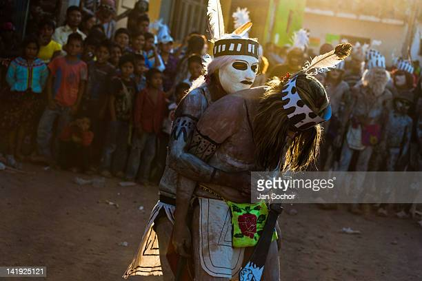 Cora Indians wearing masks and feathers perform lovemaking dance during the religious ritual celebration of Semana Santa in Jesús María Nayarit...