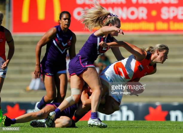 Cora Staunton looks to get rid of the football before being tackled to the ground during the round five AFLW match between the Fremantle Dockers and...