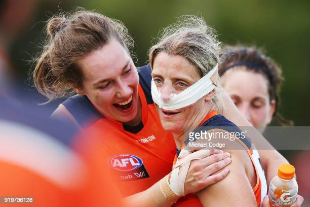 Cora Staunton of GWS celebrates the win after sustaining a nose injury with Erin McKinnon during the round three AFLW match between the Collingwood...