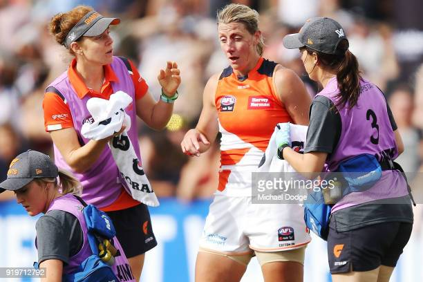 Cora Staunton of GWS comes off with a facial injury after trying to tackle Sophie Casey of the Magpies during the round three AFLW match between the...