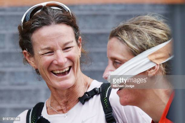 Cora Staunton of GWS who susutained an injured nose is greeted by track and field legend from Ireland Sonia O'Sullivan during the round three AFLW...