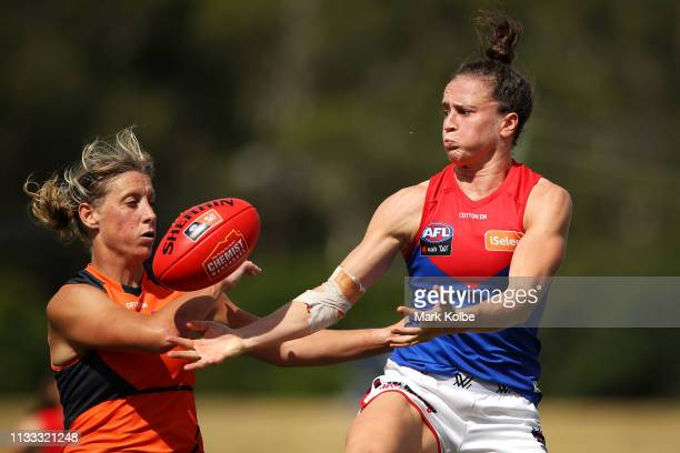 Cora Staunton of the Giants and Harriet Cordner of the Demons compete for the ball during the round five AFLW match between the Greater Western...