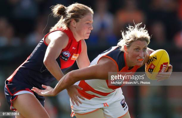 Cora Staunton of the Giants is tackled by Ashleigh Guest of the Demons during the 2018 AFLW Round 01 match between the Melbourne Demons and the GWS...