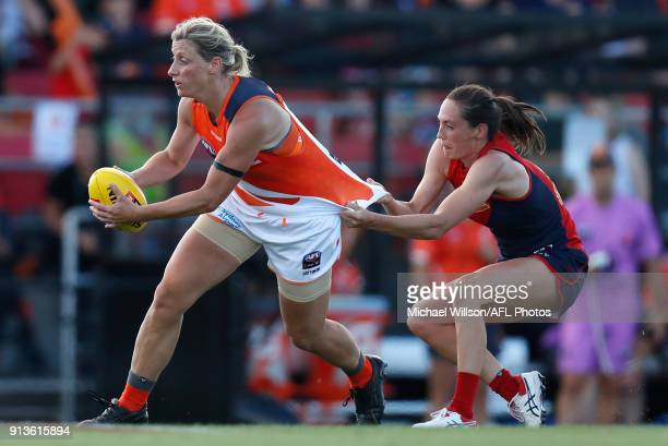 Cora Staunton of the Giants is tackled by Meg Downie of the Demons during the 2018 AFLW Round 01 match between the Melbourne Demons and the GWS...