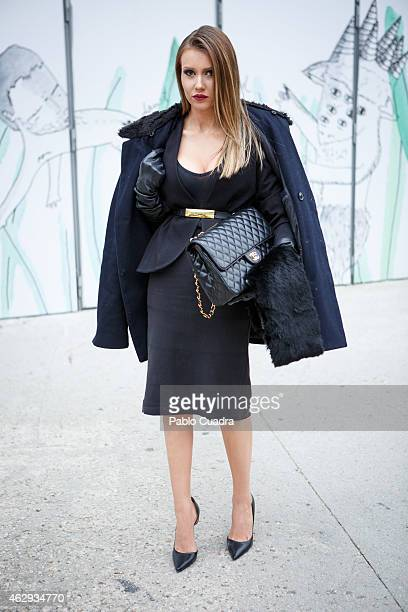 Cora wears Massimo Dutti dress Channel handbag Terry Mugre Jacket and Zara shoes during Mercedes Benz Madrid Fashion Week Fall/Winter 2015/16 at...