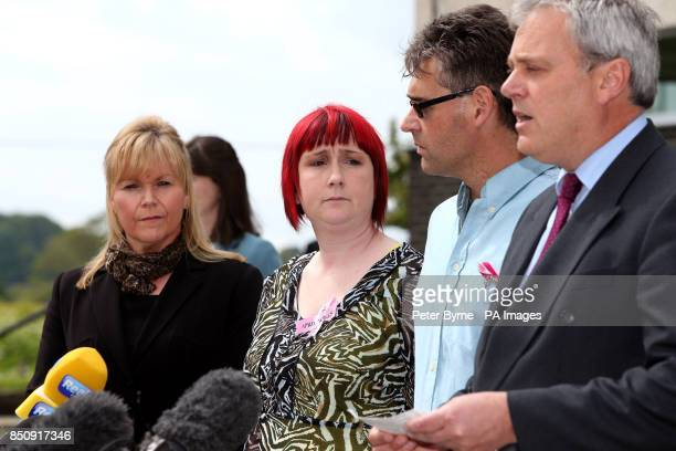 Coral and Paul Jones the parents of April Jones listen as Ed Beltrami Chief Crown Prosecutor for CPS Wales reads a statement outside Mold Crown Court...