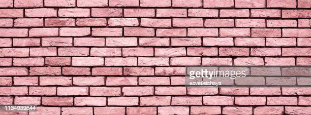 coral brick wall texture close up