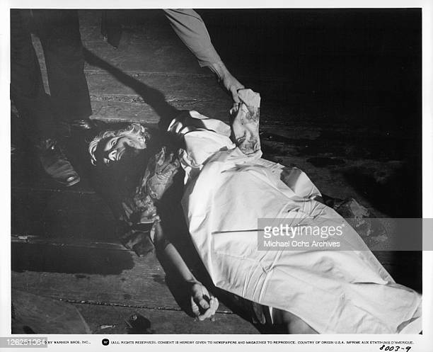 Coral Browne is discovered murdered in a scene from the film 'Drowning Pool' 1975