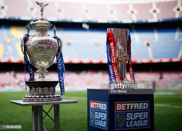 Coral Challenge Cup and Betfred Super League trophies are presented on the pitch ahead of the Betfred Super League match at Camp Nou on May 18, 2019...