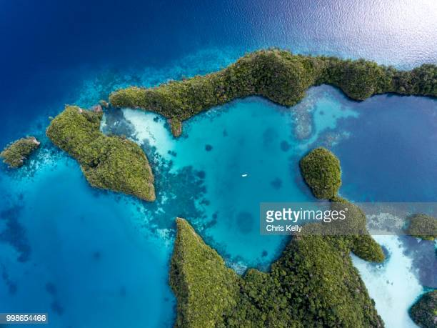 coral islands from above - pacific ocean stock photos and pictures