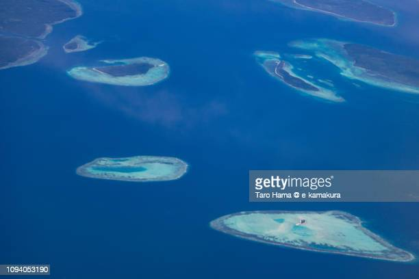 Coral reef in Balabac in Province of Palawan in Philippines daytime aerial view from airplane
