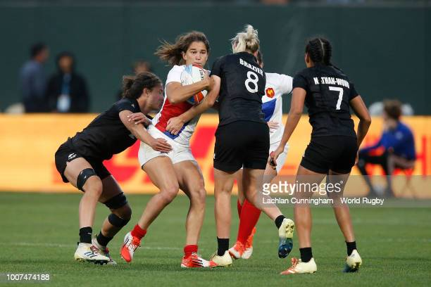 Coralie Bertrand of France is tackled by Kelly Brazier and Ruby Tui of New Zealand during the Championship final match on day two of the Rugby World...